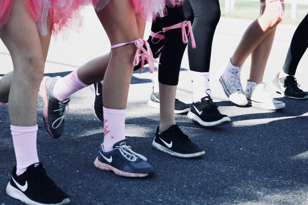 race for cancer pink ribbons and tutus